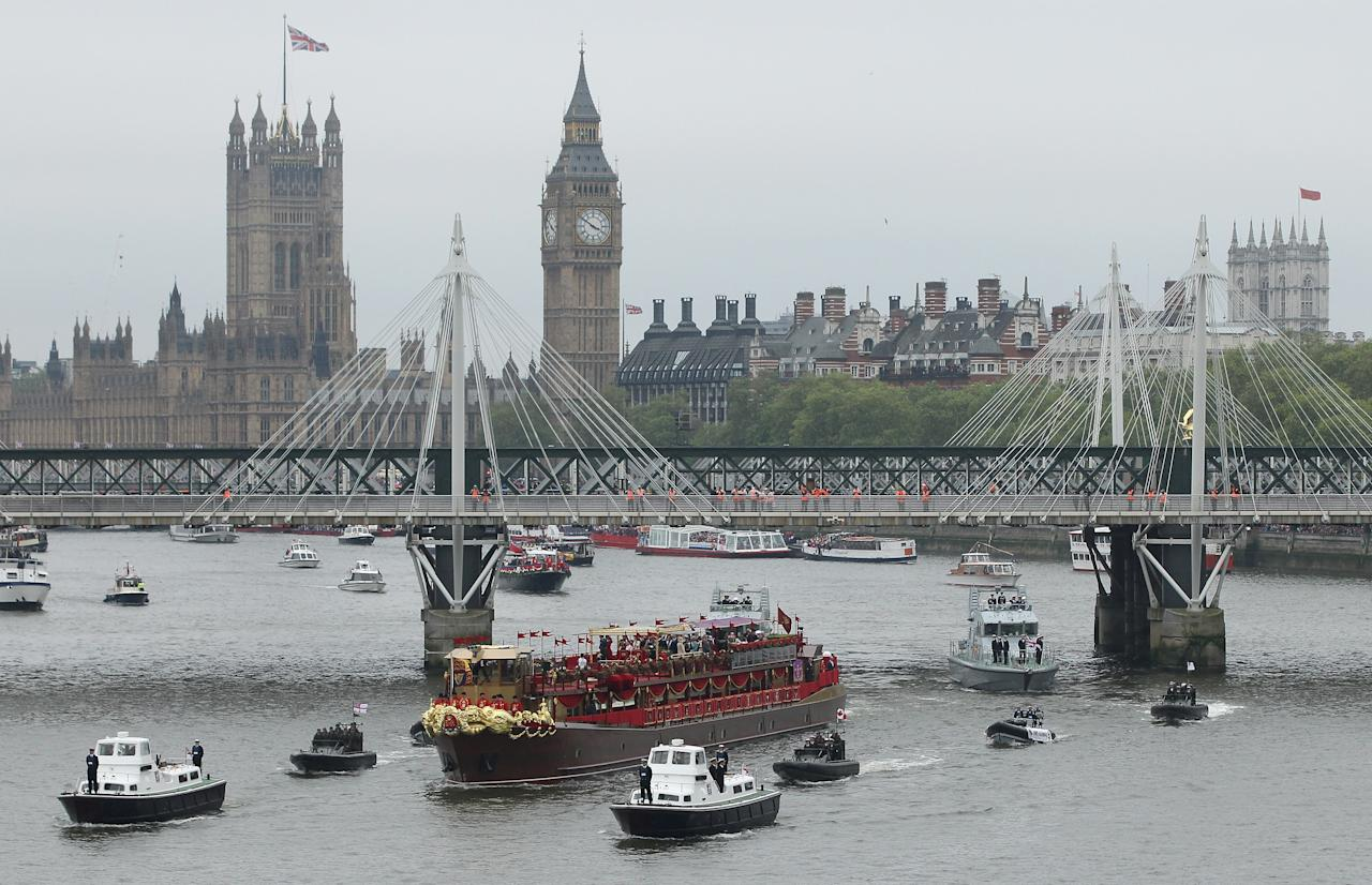 LONDON, ENGLAND - JUNE 03:  The Spirit of Chartwell, the ship carrying Queen Elizabeth II and members of the royal family, passes under Jubilee Bridge as Big Ben and Parliament stand behind during the River Pageant of the Diamond Jubilee on June 3, 2012 in London, England. For only the second time in its history the UK celebrates the Diamond Jubilee of a monarch. Her Majesty Queen Elizabeth II celebrates the 60th anniversary of her ascension to the throne. Thousands of well-wishers from around the world have flocked to London to witness the spectacle of the weekend's celebrations. The Queen, along with all members of the royal family, will participate in a River Pageant with a flotilla of a 1,000 boats accompanying them down the Thames, a star studded free concert at Buckingham Palace and a carriage procession and a service of thanksgiving at St Paul's Cathedral.  (Photo by Sean Gallup/Getty Images)
