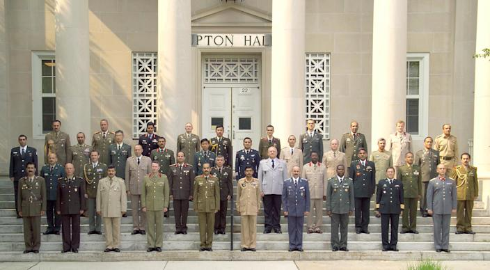 This undated 2006 photograph provided by the U.S. Army War College photo lab shows Egyptian Maj. Gen. Abdel-Fattah el-Sissi, center row, fifth from left, in a group photo of the International Fellows class of 2006 in Carlisle, Pennsylvania. The head of Egypt's military, Abdel-Fattah el-Sissi, is riding on a wave of popular fervor that is almost certain to carry him to election as president. Unknown only two years ago, a broad sector of Egyptians now hail him as the nation's savior after he ousted the Islamists from power, and the state-backed personality cult around him is so eclipsing, it may be difficult to find a candidate to oppose him if he runs. Still, if he becomes president, he faces the tough job of ruling a deeply divided nation that has already turned against two leaders.(AP Photo/U.S. Army War College photo lab)