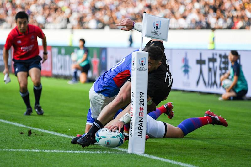 New Zealand's scrum-half TJ Perenara (C) scores a try during the Japan 2019 Rugby World Cup Pool B match between New Zealand and Namibia at the Tokyo Stadium in Tokyo on October 6, 2019. (Photo by CHARLY TRIBALLEAU / AFP) (Photo by CHARLY TRIBALLEAU/AFP via Getty Images)