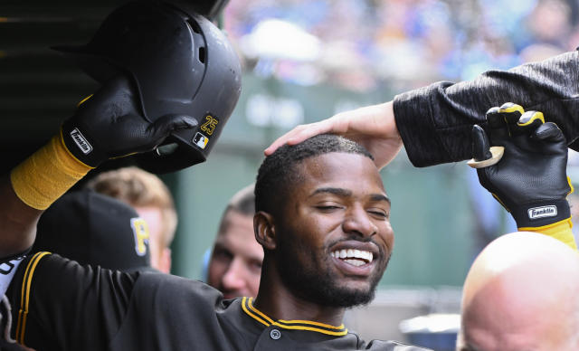 Pittsburgh Pirates Gregory Polanco celebrates in the dugout after hitting a home run in the seventh inning of a baseball game against the Chicago Cubs, Thursday, April 12, 2018, in Chicago. (AP Photo/Matt Marton)