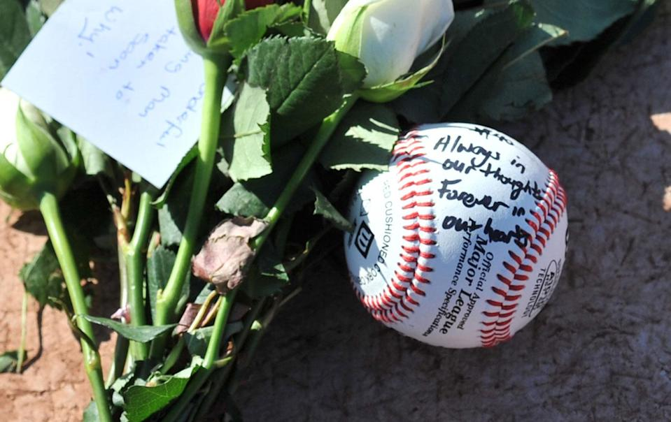 A tribute to Chris Lane on the home plate at Essendon Baseball Club in Melbourne. Source: AAP