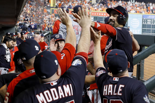 Washington Nationals' Anthony Rendon celebrates in the dugout after scoring on a double by Juan Soto during the fifth inning of Game 1 of the baseball World Series against the Houston Astros Tuesday, Oct. 22, 2019, in Houston. (AP Photo/Matt Slocum)