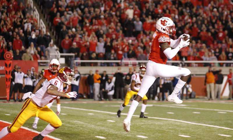 Utah defensive back Jaylon Johnson (1) catches a interception in front of Southern California wide receiver Michael Pittman Jr. (6) in the second half during an NCAA college football game against Southern California Saturday, Oct. 20, 2018, in Salt Lake City. (AP Photo/Rick Bowmer)