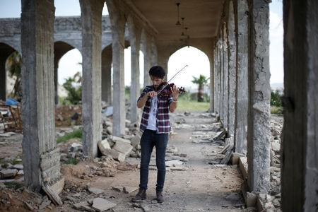 Ameen Mukdad, a violinist from Mosul who lived under ISIS's rule for two and a half years where they destroyed his musical instruments, performs in eastern Mosul