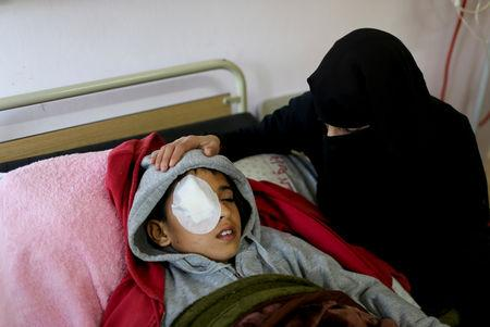 Lamia Abu Harb sits next to her sone Mohammad An-Najjar, 12, who was wounded in his eye during a protest at the Israel-Gaza border fence, in Khan Younis, in the southern Gaza Strip, January 13, 2019. REUTERS/Ibraheem Abu Mustafa