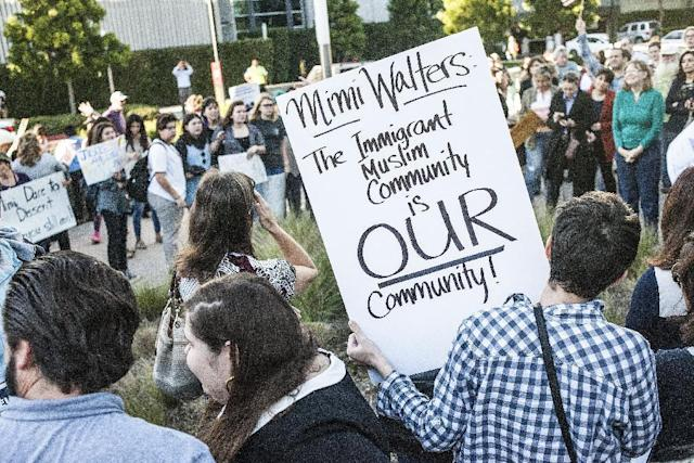 Protesters stand outside the office of U.S. Rep. Mimi Walters to request a town hall meeting with her in Irvine, Calif., on Jan. 31, 2017. (Photo: Nick Agro/The Orange County Register via AP)