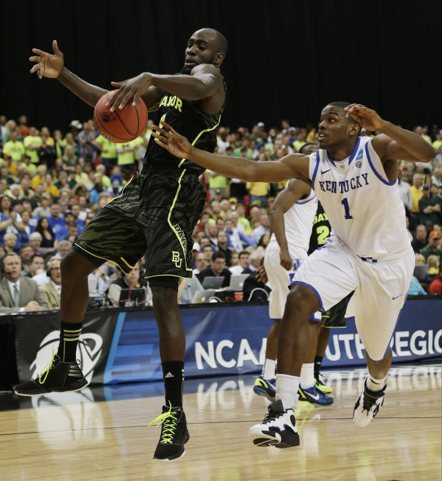 Baylor's Perry Jones III (1) and Kentucky's Darius Miller (1) vie for a lose ball during the second half of an NCAA tournament South Regional finals college basketball game Sunday, March 25, 2012, in Atlanta. (AP Photo/David J. Phillip)