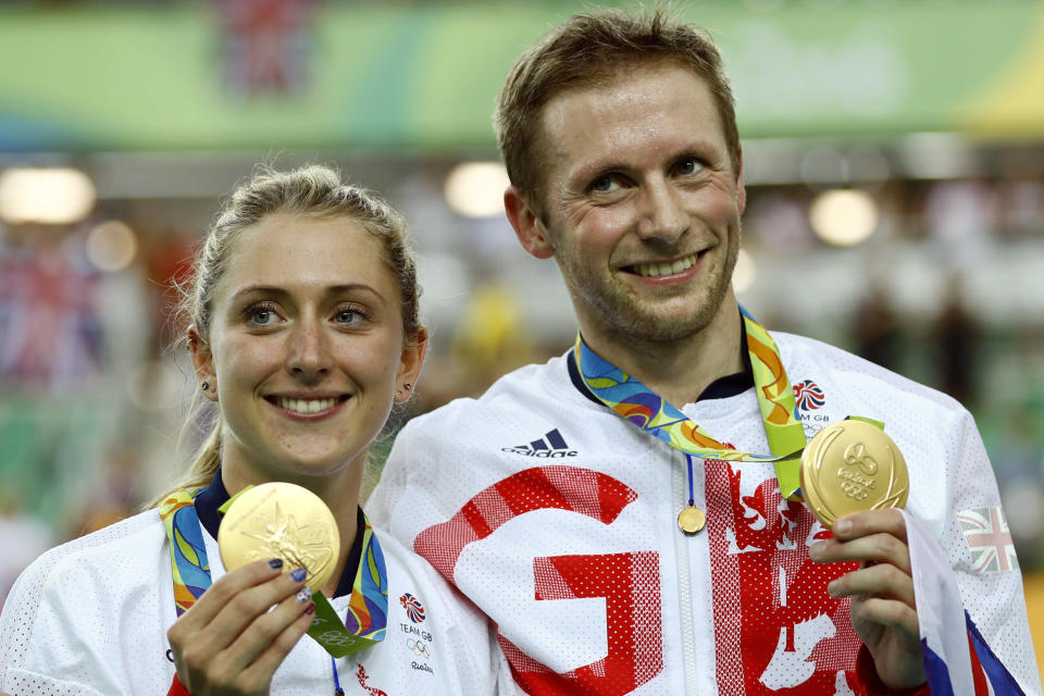 FILE - Laura Trott, left, and her fiance Jason Kenny, both of Britain, pose with their gold medals at the Rio Olympic Velodrome during the 2016 Summer Olympics in Rio de Janeiro, Brazil, in this Tuesday, Aug. 16, 2016, file photo. Britain is hoping to back up consecutive dominant performances in Olympic cycling at the Tokyo Games next month, though much has changed since Rio. Allegations of bullying, sexism and discrimination along with doping charges leveled at its ex-chief doctor have led to leadership changes at British Cycling. Still, such riders at the husband-wife track duo of Jason and Laura Kenny and youngsters such as Tao Geoghegan Hart have the British team eyeing more gold in Japan. (AP Photo/Patrick Semansky, File)