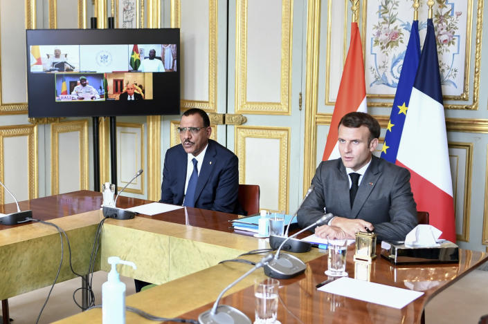 French President Emmanuel Macron and Niger's President Mohamed Bazoum, left, attend a video summit with leaders of G5 Sahel countries after France's decision last month to reduce French anti-terror troops in West Africa, at the Elysee presidential Palace in Paris, Friday July 9, 2021. (Stephane de Sakutin, Pool photo via AP)