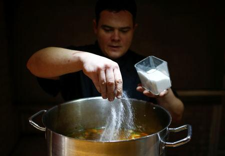 FILE PHOTO: A chef of Caffe Italia restaurant cooks soup as part of a charity program to help homeless people in St. Petersburg, Russia November 28, 2018. REUTERS/Anton Vaganov