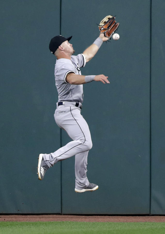 Chicago White Sox's Adam Engel jumps for Cleveland Indians' Michael Brantley's one-run double in the seventh inning of a baseball game, Tuesday, June 19, 2018, in Cleveland. Rajai Davis scored on the play. (AP Photo/Tony Dejak)
