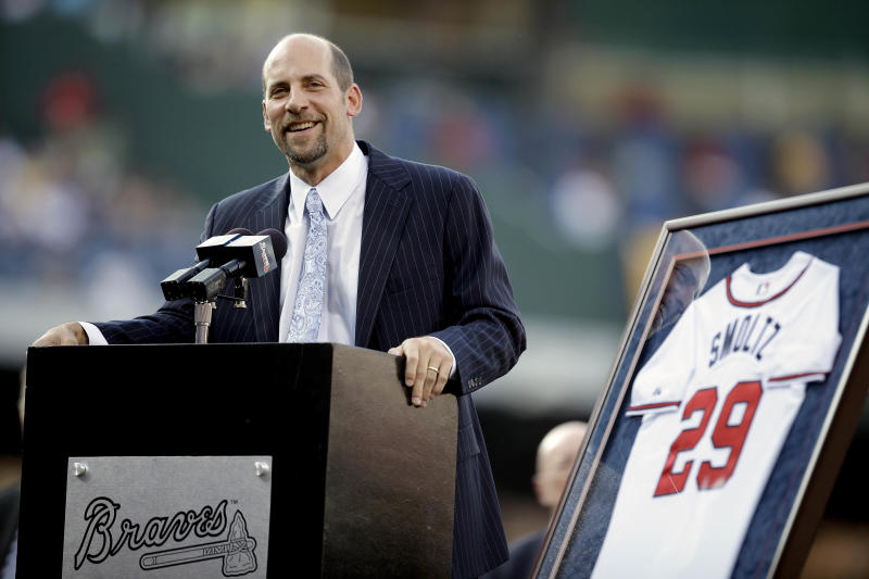 Former Atlanta Braves pitcher John Smoltz speaks during a ceremony retiring his jersey before a baseball game between the Braves and the Toronto Blue Jays, Friday, June 8, 2012, in Atlanta. Smoltz took his place in Braves history on Friday night when the team retired his No. 29. He was inducted into the Braves Hall of Fame earlier in the day. (AP Photo/David Goldman)