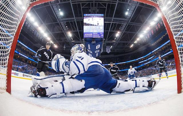 """TAMPA, FL – MARCH 16: Goalie <a class=""""link rapid-noclick-resp"""" href=""""/nhl/players/5161/"""" data-ylk=""""slk:Frederik Andersen"""">Frederik Andersen</a> #31 of the Toronto Maple Leafs makes a save against <a class=""""link rapid-noclick-resp"""" href=""""/nhl/players/5982/"""" data-ylk=""""slk:Jonathan Drouin"""">Jonathan Drouin</a> #27 of the <a class=""""link rapid-noclick-resp"""" href=""""/nhl/teams/tam/"""" data-ylk=""""slk:Tampa Bay Lightning"""">Tampa Bay Lightning</a> during the second period at Amalie Arena on March 16, 2017 in Tampa, Florida. (Photo by Scott Audette/NHLI via Getty Images)"""