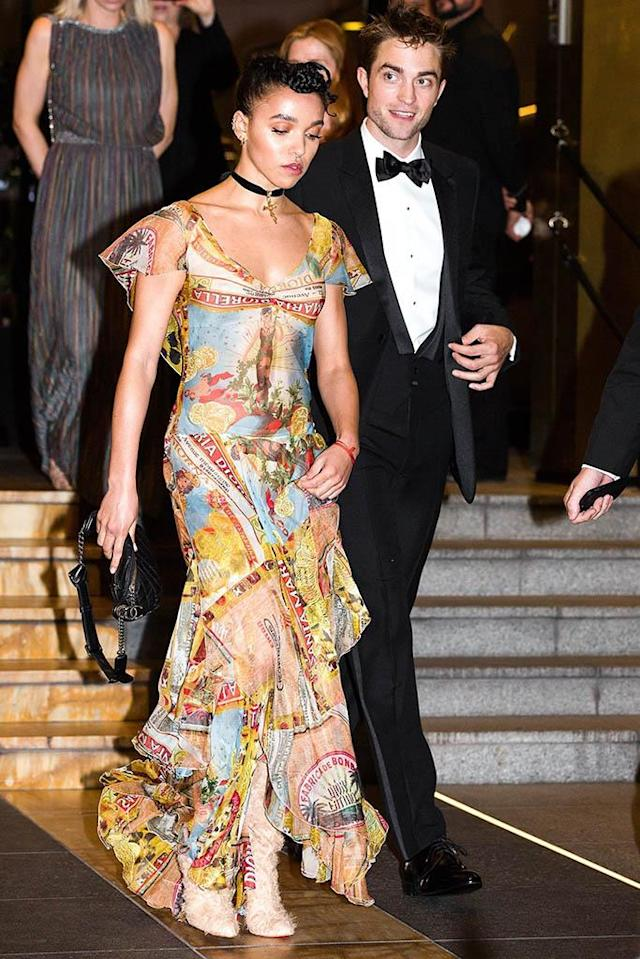 <p>Robert Pattinson and FKA Twigs are still going strong! Though the British singer didn't walk the red carpet with her beau at a screening of his movie <em>Good Time </em>at the Cannes Film Festival, the couple were spotted exiting their hotel together. (Photo: BackGrid) </p>