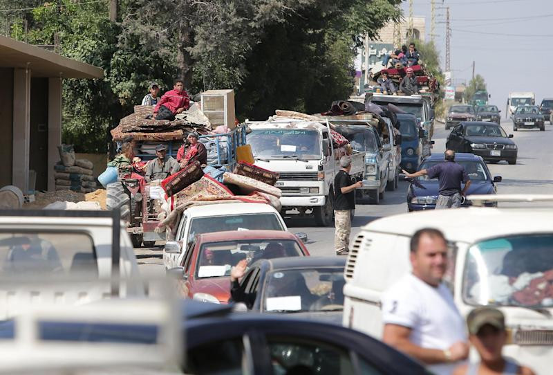 Syrian refugees are driven through the Lebanese village of Labweh in the Bekaa Valley on August 7, 2014 (AFP Photo/Joseph Eid)