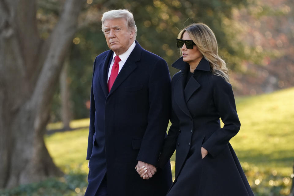 President Donald Trump and first lady Melania Trump walk to board Marine One on the South Lawn of the White House, Wednesday, Dec. 23, 2020, in Washington. (AP Photo/Evan Vucci)