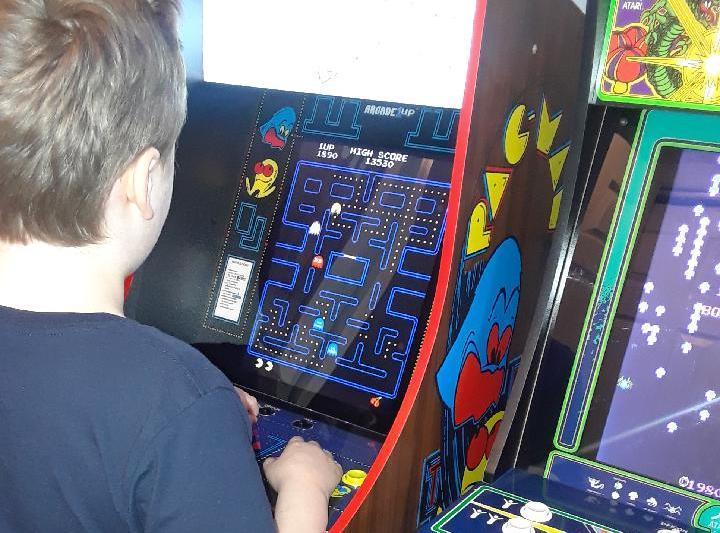 Lucas, 9-years-old, trying out Pac-Man on a Arcade1Up cabinet.