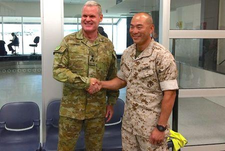 U.S. Marines commander Lieutenant Colonel Brian Middleton shakes hands with Australian Army Brigadier Ken James after arriving for the sixth annual Marines' deployment at Darwin in northern Australia