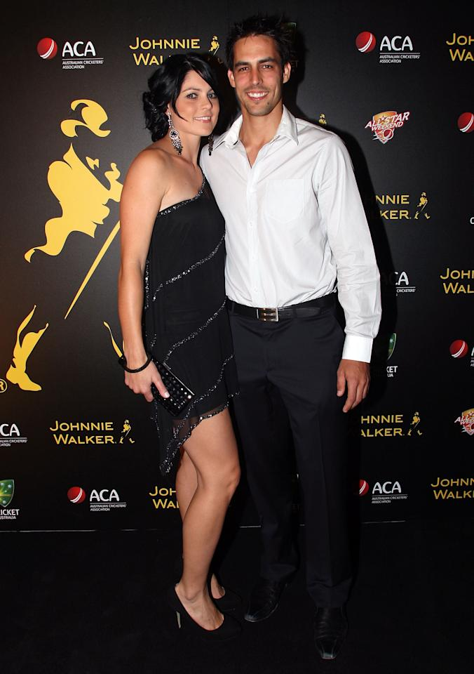 BRISBANE, AUSTRALIA - NOVEMBER 23:  Mitchell Johnson arrives with partner Jessica Bratich for the Johnnie Walker All*Star party at the Gallery of Modern Art on November 23, 2009 in Brisbane, Australia.  (Photo by Bradley Kanaris/Getty Images)