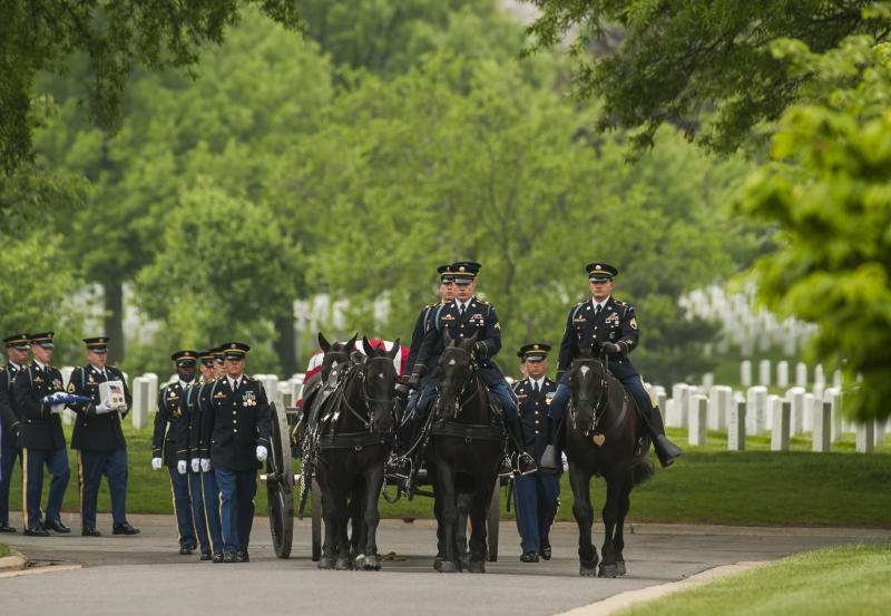 A caisson carries the remains of U.S. Army 1st Lt. Zuinglius K. McCormack, a Civil War veteran, during committal services at Arlington National Cemetery on Thursday, May 9, 2013 in Arlington, Va. Arlington National Cemetery dedicated its ninth columbarium court by conducting a joint full honors committal service for six unclaimed remains of veterans from all branches of the Armed Forces. (AP Photo/Kevin Wolf)