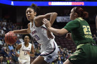 Connecticut's Olivia Nelson-Ododa, left, drives around South Florida's Tamara Henshaw during the first half of an NCAA college basketball game in the American Athletic Conference tournament seminfals at Mohegan Sun Arena, Sunday, March 8, 2020, in Uncasville, Conn. (AP Photo/Jessica Hill)