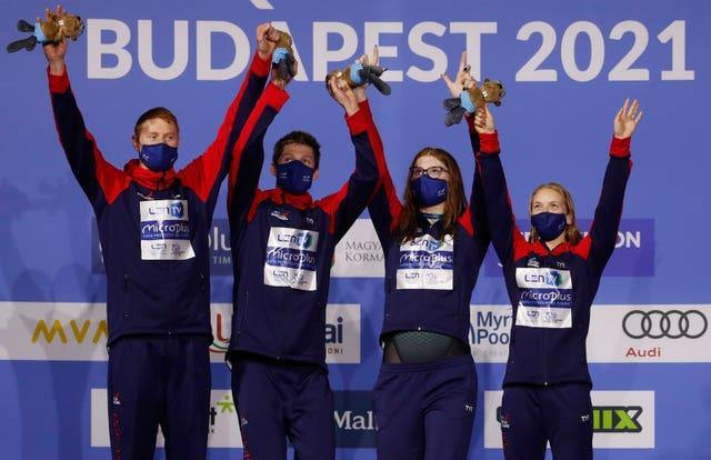 Great Britain celebrates after winning the mixed 4 x 100 metres relay final