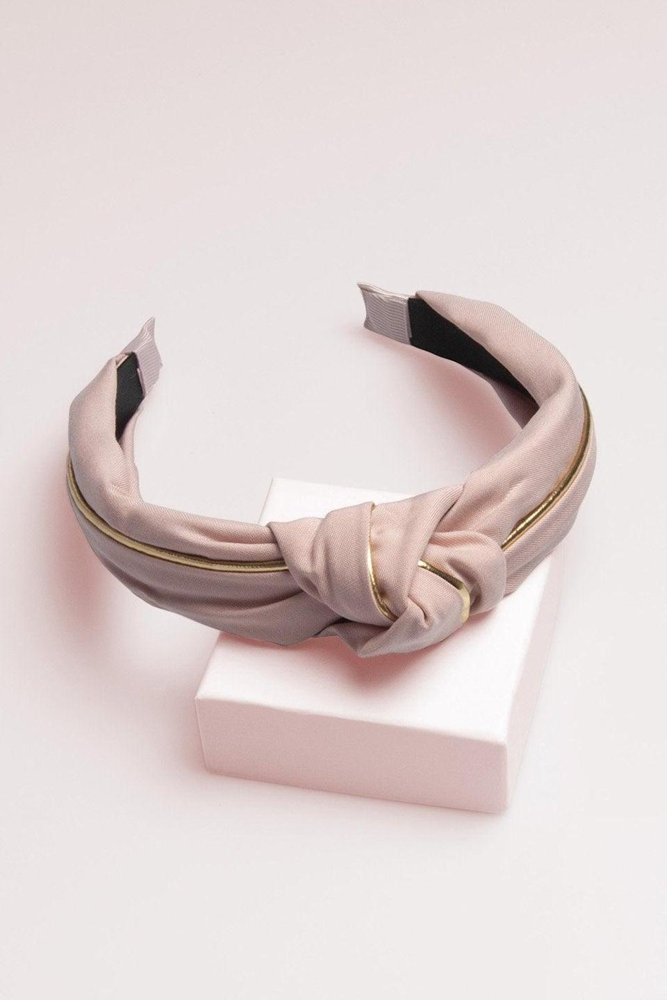 """<h2>The Hair Edit Knotted Headband</h2> <br>The gold accent on this blush-colored band will add a touch of elegance to any summer outfit, from a floral maxi dress to your two-piece sweatsuit.<br><br><br><strong>the hair edit</strong> Knotted Headband, $, available at <a href=""""https://go.skimresources.com/?id=30283X879131&url=https%3A%2F%2Fwww.thehairedit.com%2Fproducts%2Fknotted-headband"""" rel=""""nofollow noopener"""" target=""""_blank"""" data-ylk=""""slk:The Hair Edit"""" class=""""link rapid-noclick-resp"""">The Hair Edit</a><br><br>"""