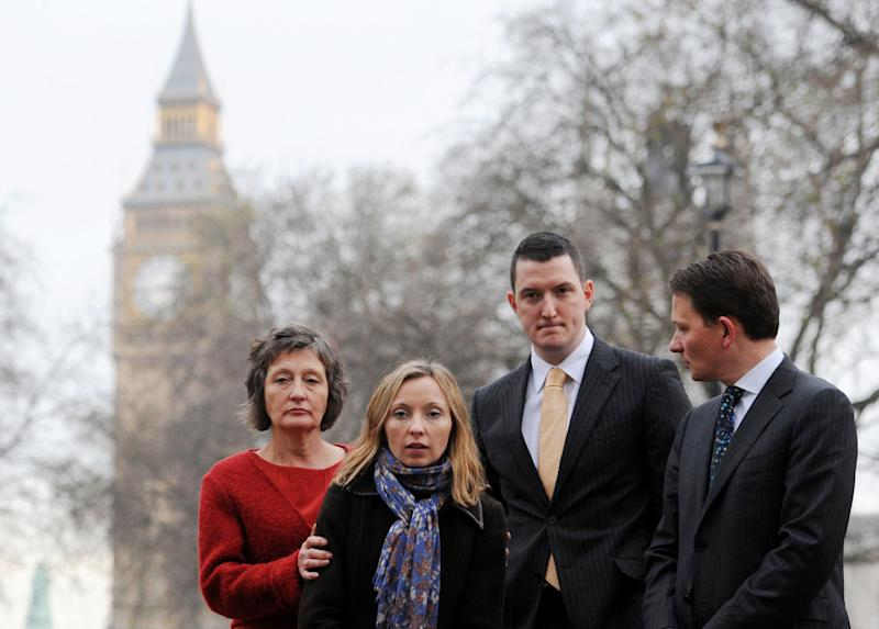 "The Finucane family including Geraldine Finucane, left, and her three children, Michael, right, Katherine, 2nd left, and John, 2nd right, arrive to hold a press conference in Westminster, central London, Wednesday, Dec. 12, 2012, after hearing the report by Sir Desmond de Silva into the murder of Belfast solicitor Pat Finucane in 1989. Two gunmen from the Ulster Defense Association shot him more than a dozen times in his Belfast home as he was having Sunday lunch with his wife, Geraldine and three children. Employees of the state and state agents played ""key roles"" in the murder, the report says. (AP Photo/PA, Stefan Rousseau) UNITED KINGDOM OUT  NO SALES  NO ARCHIVE"