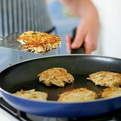 "<p>The reserved potato starch helps bind the potato-onion mixture and adds heft to this traditional Hanukkah treat. Use the shredding blade of a food processor for the quickest prep and the fluffiest texture. Thoroughly combine the potato and onion, as the onion helps prevent discoloration. Serve latkes with applesauce and sour cream. </p><p><a href=""https://www.myrecipes.com/recipe/basic-potato-latkes"">Basic Potato Latkes Recipe</a></p>"