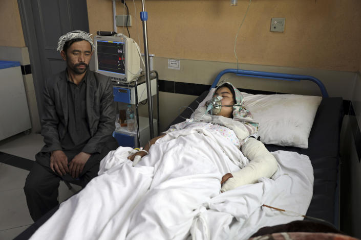 An Afghan student is treated at a hospital after she was injured by deadly bombings targeting a school in Kabul, Afghanistan, May 10, 2021. / Credit: Rahmat Gul/AP