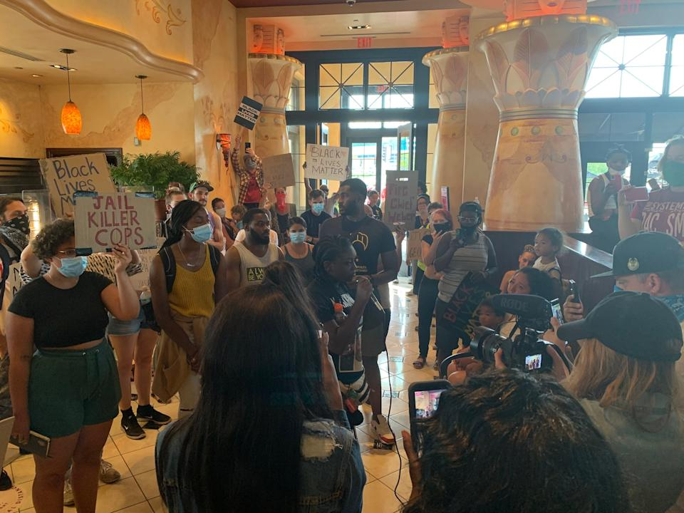 A group of protesters entered The Cheesecake Factory to participate in a sit-in on July 2. Alvin Cole, 17, was fatally shot by a Wauwatosa police officer in the parking lot of the restaurant in February.