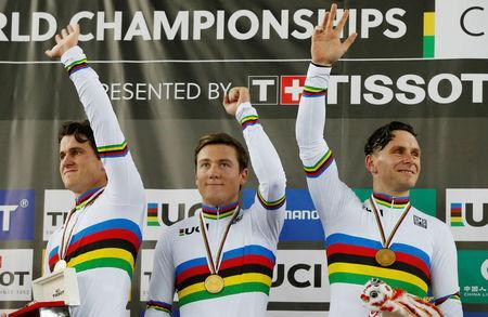 Cycling - UCI Track World Championships - Men's Team Sprint, Final - Hong Kong, China – 12/4/17 - New Zealand's Sam Webster, Ethan Mitchell and Edward Dawkins celebrate with gold medals. REUTERS/Bobby Yip