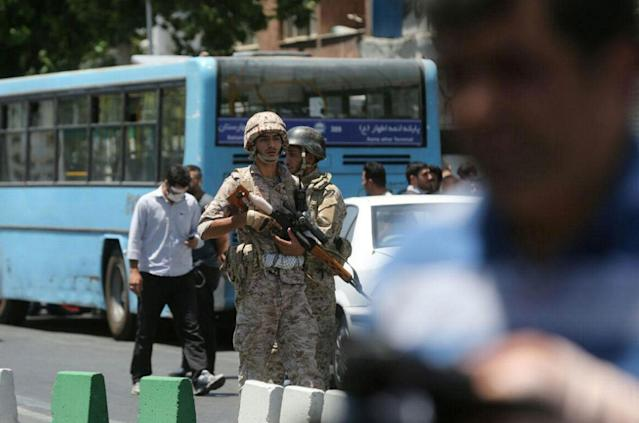 <p>Members of Iranian forces stand guard during an attack on the Iranian parliament in central Tehran, Iran, June 7, 2017. (Photo: Omid Vahabzadeh/TIMA via Reuters) </p>