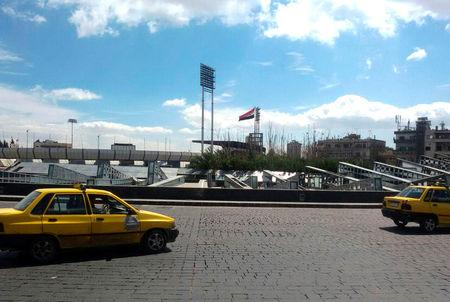 Vehicles drive at Abbasiyin square in the east of the capital Damascus, in this handout picture provided by SANA on March 20, 2017, Syria. SANA/Handout via REUTERS