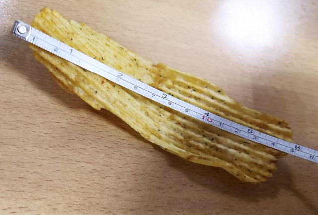 A man has found a six-inch crisp (SWNS)