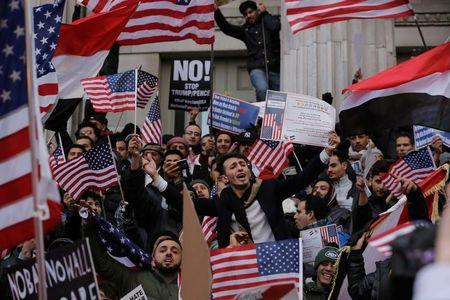 Demonstrators participate in a protest by the Yemeni community against U.S. President Donald Trump's travel ban in the Brooklyn borough of New York