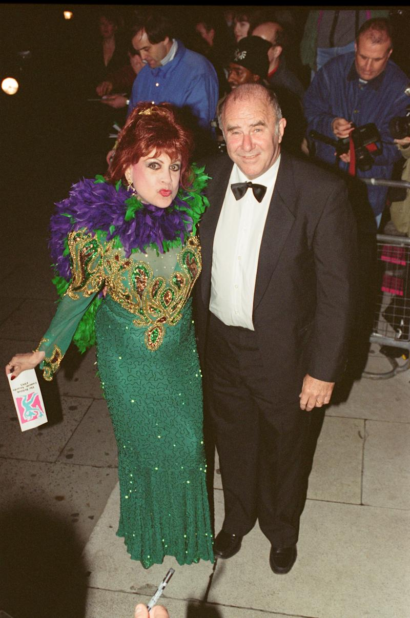 Clive James arrives for the 1995 Comedy Awards with Margarita Pracatan, a Cuban novelty singer, who found success in the 1990s when Clive James had her perform live on his TV show on numerous occasions. Picture taken 2nd December 1995. (Photo by Roy Fisher/Mirrorpix/Getty Images)