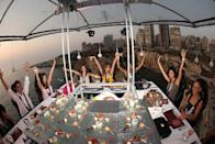"""<p>Enjoy dinner in the air with this service. The 22-person dining table is hoisted up using an industrial crane and the guests are served by a personal chef, who prepares the finest meal 35m above the ground. <a href=""""http://dinnerinthesky.com/photos/#gallery/15463/140"""" rel=""""nofollow noopener"""" target=""""_blank"""" data-ylk=""""slk:(Photo Credit)"""" class=""""link rapid-noclick-resp""""><i>(Photo Credit)</i></a></p>"""