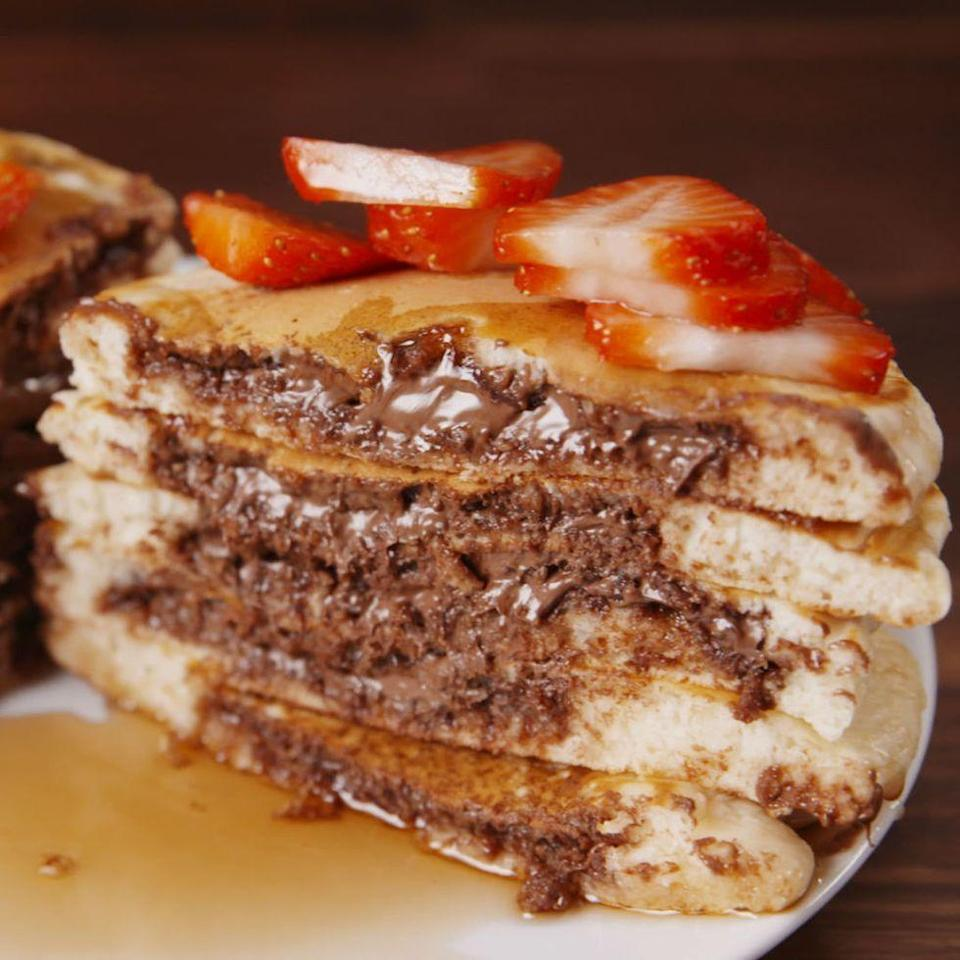 """<p>Nutella lovers will freak out over these stuffed pancakes.</p><p>Get the <a href=""""https://www.delish.com/uk/cooking/recipes/a35403622/nutella-stuffed-pancakes-recipe/"""" rel=""""nofollow noopener"""" target=""""_blank"""" data-ylk=""""slk:Nutella-Stuffed Pancakes"""" class=""""link rapid-noclick-resp"""">Nutella-Stuffed Pancakes</a> recipe. </p>"""
