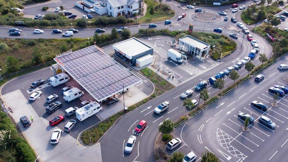 Vehicles queue for fuel at a Sainsbury's petrol station in Weymouth, England