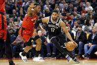 Brooklyn Nets guard Garrett Temple (17) drives to the hoop against Toronto Raptors guard Kyle Lowry (7) during the first half of an NBA basketball game in Toronto, Saturday, Dec. 14, 2019. (Cole Burston/The Canadian Press via AP)
