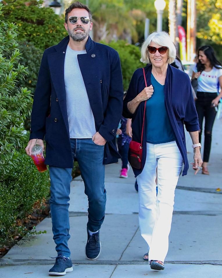 Ben Affleck heads out for a walk in Los Angeles with mom Christine Anne Boldt on Friday.