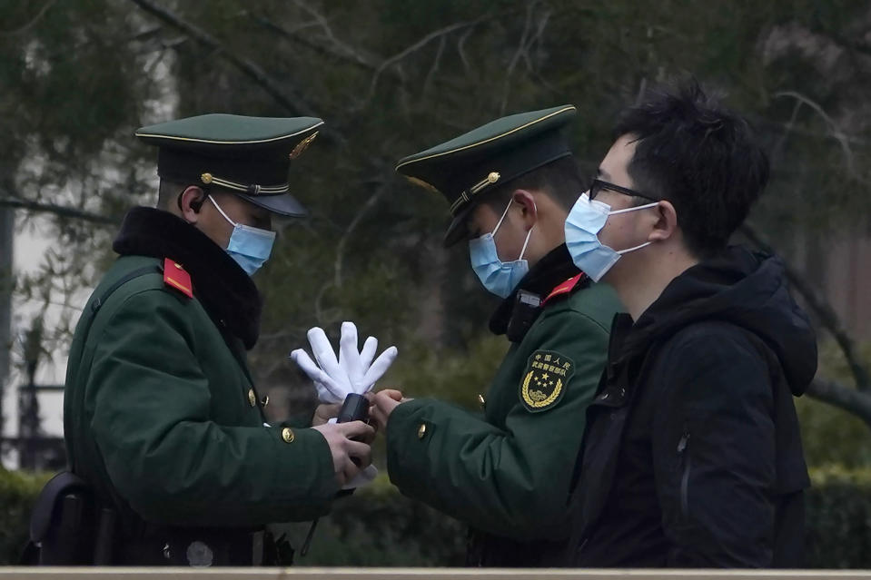 Chinese paramilitary policemen change shifts on the streets of Beijing near the Great Hall of the People Wednesday, March 3, 2021. In a sign of confidence China has reverted back to holding its annual Congress meetings to march this year after delaying them due to the outbreak of the coronavirus last year. As usual, security has been tightened in the capital with paramilitary troops patrolling near the Great Hall of the People where the meetings are held and standing guard at subway stations. (AP Photo/Ng Han Guan)