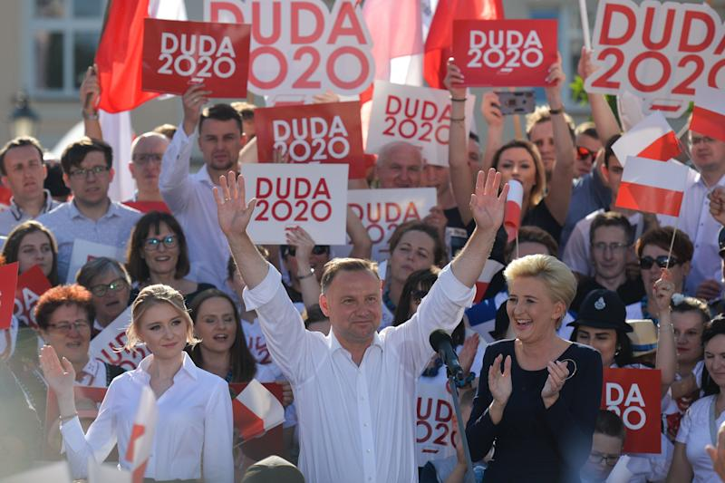 Andrzej Duda (C), the current Polish President and candidate for the presidential election 2020, accompanied by wife Agata (R) and daughter Kinga (L), seen during the final day of his presidential campaign rally in Rzeszow. On July 10, 2020, in Rzeszow, Podkarpackie Voivodeship, Poland. (Photo by Artur Widak/NurPhoto via Getty Images) (Photo: NurPhoto via Getty Images)