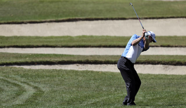John Senden, of Australia, hits from the rough on the 18th fairway during the third round of the Valspar Championship golf tournament at Innisbrook Saturday, March 15, 2014, in Palm Harbor, Fla. (AP Photo/Chris O'Meara)