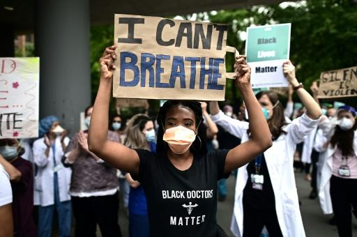 Nurses and healthcare workers attend a 'Black Lives Matter' rally in front of Bellevue Hospital on June 4, 2020, in New York City
