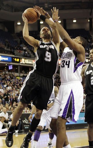 San Antonio Spurs guard Tony Parker, left, goes to the basket against Sacramento Kings forward Jason Thompson during the first quarter of an NBA basketball game in Sacramento, Calif., Wednesday, March 28, 2012. (AP Photo/Rich Pedroncelli)
