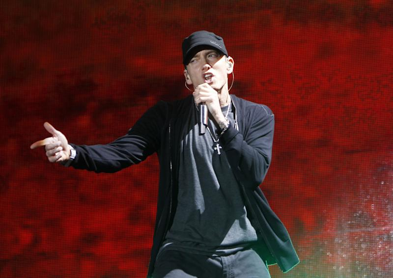 FILE - In this Sept. 13, 2010 file photo, rapper Eminem performs at Yankee Stadium in New York. (AP Photo/Jason DeCrow, file)