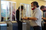 U.S. Senator Ted Cruz (R-TX) checks his documentation at an airline counter at the Cancun International Airport before boarding his plane back to the U.S., in Cancun