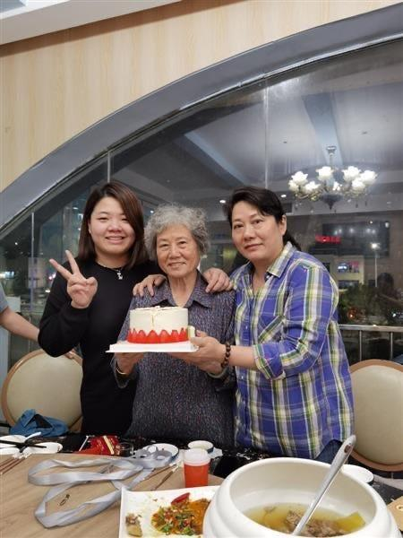 """Xiaojie """"Emily"""" Tan's family in China celebrated what would have been her 50th birthday this week. Tan's mother, center, had not been told of her daughter's death because family members were worried it would make her sick."""